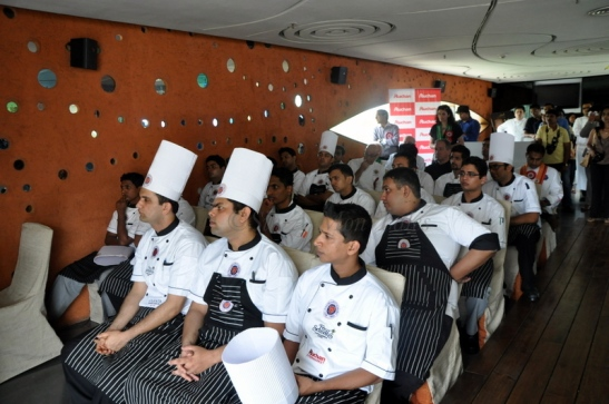 The young chef's listening with rapt attention
