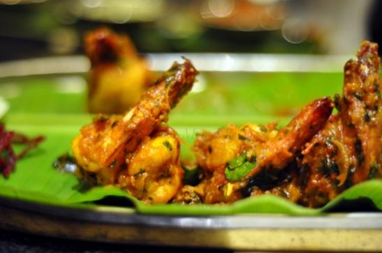 Kuttanadan Karuvapila Konju : Tiger Prawn pan fried with onion and tomato with some fresh curry leaves  Yumminess