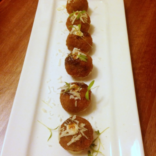 Pesto Arancini : Arancini ae rice balls filled with melting cheese, usually made with leftover risotto. These flavored with Pesto were stellar